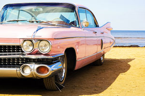 Pink Cadillac parked on the beach
